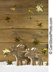 Two wooden elks on wooden christmas background. Vertikal...
