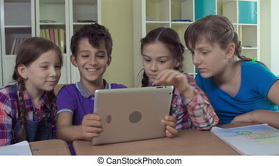 Computerate Generation - Four kids having fun with digital...