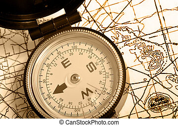 Compass on a map Duotone - A compass lying on top of a...