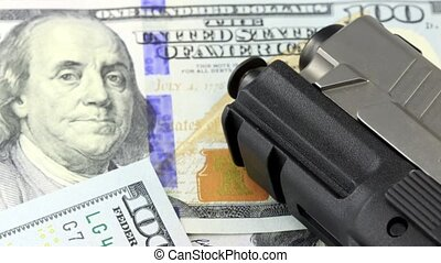 Weapons and Money - Hand Gun with American Currency -...