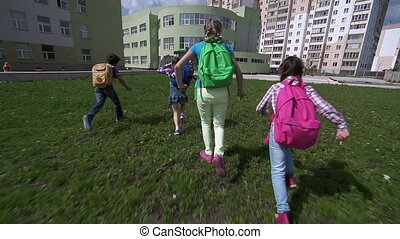 Late-Comers - Camera following three kids with backpacks...