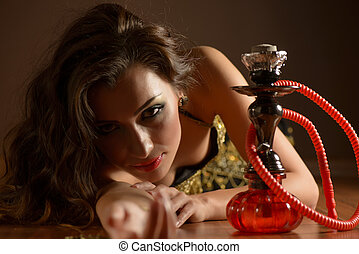 Belly dancer posing with hookah - Beautiful belly dancer...
