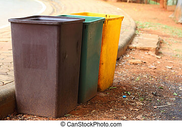 Yellow, green, brown bins at the park