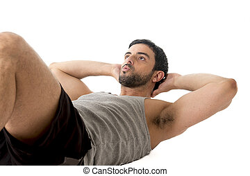 attractive latin sport man wearing running clothes doing sit...