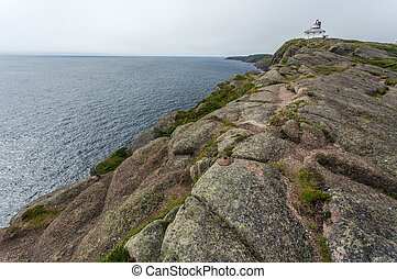 old Cape Spear lighthouse along rocky coast, Newfoundland,...