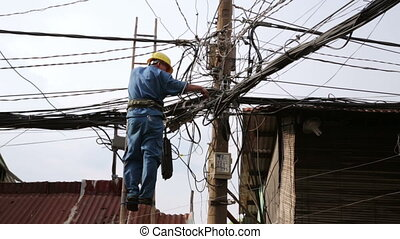 electrician fixing, repairing messy electric cables in hanoi...