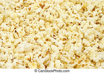 Popcorn Background - A macro shot of popcorn that is filling...
