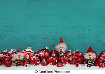 Turquoise green wooden christmas background with red balls -...