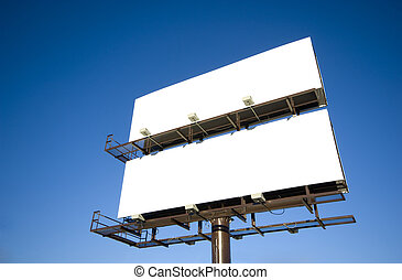Blank Billboards - Blank billboards against a bright blue...