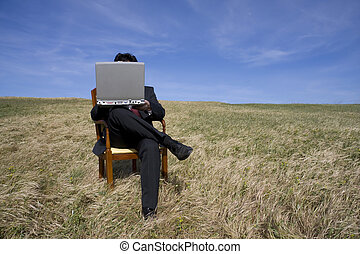 Working out - Business man sitting on a chair working out