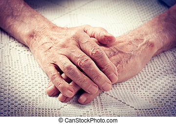 Old people holding hands - Care is at home of elderly Old...