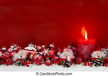Red christmas candle with balls and imp on wooden...