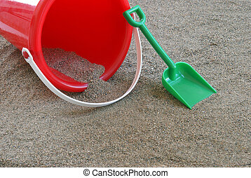 Sand Toys - A shovel and bucket in the sand.