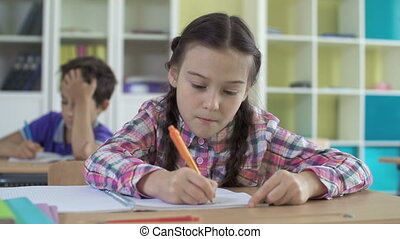 Lesson in Drawing - Close up of girl focused on drawing, her...