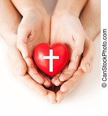 couple hands holding heart with cross symbol - religion,...