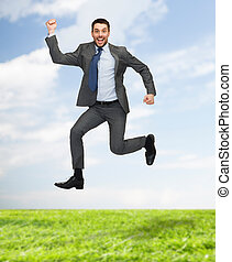smiling happy businessman jumping - business, education and...