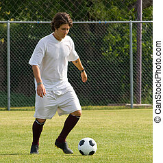 Soccer - Football Player Dribbling - Soccer or bootball...