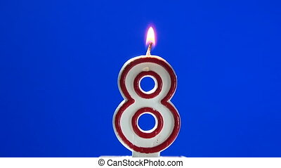 Number 8 - eight birthday candle burning - blow out at the...