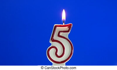Number 5 - five birthday candle burning - blow out at the...