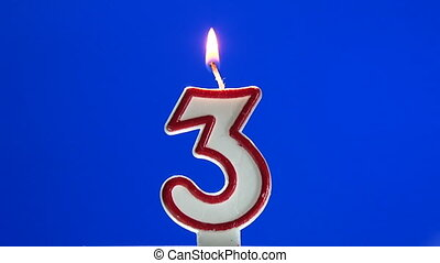 Number 3 - three birthday candle burning - blow out at the...