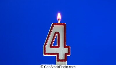 Number 4 - four birthday candle burning - blow out at the...