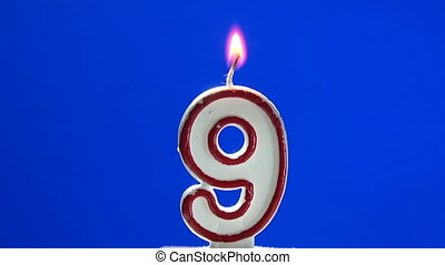 Number 9 - nine birthday candle burning - blow out at the...