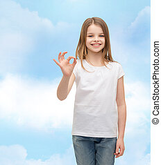 little girl in white t-shirt showing ok gesture - happy...