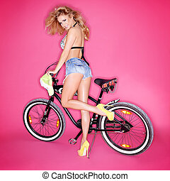Sexy blond woman with a bicycle - Sexy leggy shapely blond...