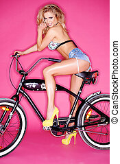 Seductive young blond on a bicycle - Seductive young blond...