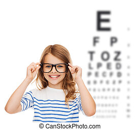 smiling cute little girl with black eyeglasses - education,...