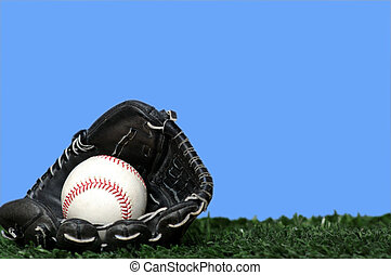 Baseball and Glove - A black leather baseball glove or mitt...