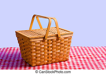 Picnic Basket on Table - a brown wicker antique picnic...