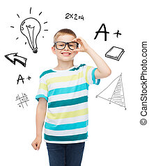 smiling little boy in eyeglasses - vision, education and...