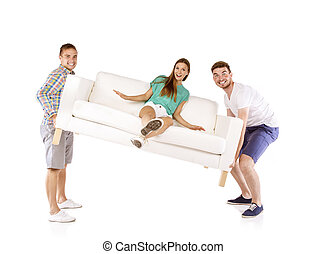 Men lifting sofa - Two young handsome men lifting sofa with...
