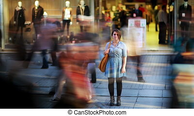 Girl in front of shopping mall, zoom in, timelapse, HD