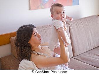 Diaper odor - Mom smelling poo odor from baby diaper