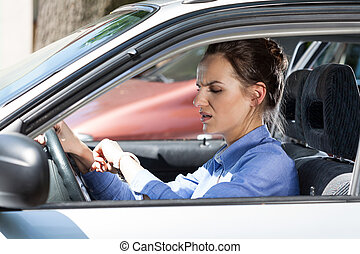 Woman late for work in a car