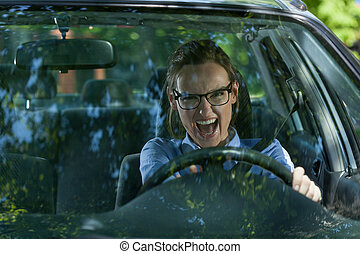 Mad woman in a car - Mad woman late for work in a car