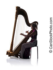 Silhouette of woman with harp - Silhouette of elegant woman...