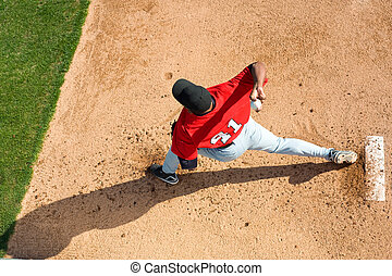 Baseball Pitcher - a baseball pitcher throwing a pitch with...