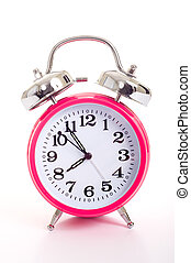 A pink alarm clock on a white background - a bright pink...