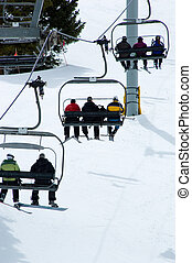 Ski Lift - A ski lift carrying skiers to the top of the...