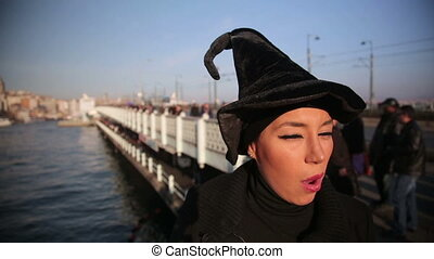Woman with witch hat outside istanbul city