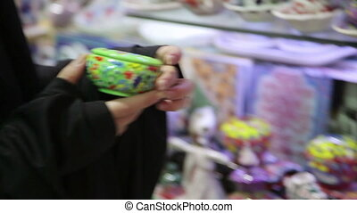 Steadycam - Woman with headscarf shopping at Grand Bazaar,...