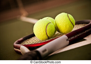 Tennis - A shot of a tennis racquet and tennis balls on the...