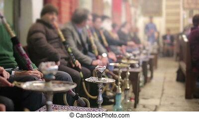 People smoking shisha at Nargile Cafe, Istanbul - People...