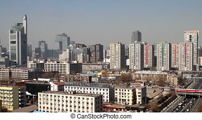 The buildings and traffic near Guomao - The buildings and...