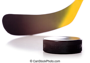 Hockey Stick and Puck - A colorful hockey stick and puck on...