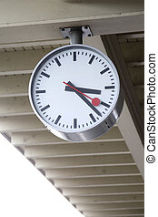 Station Clock - 01 - A train station clock hanging on the...