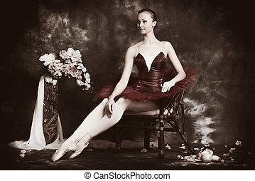 refinement - Beautiful ballet dancer posing at studio over...